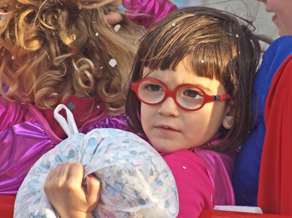 Girl in pink with red glasses